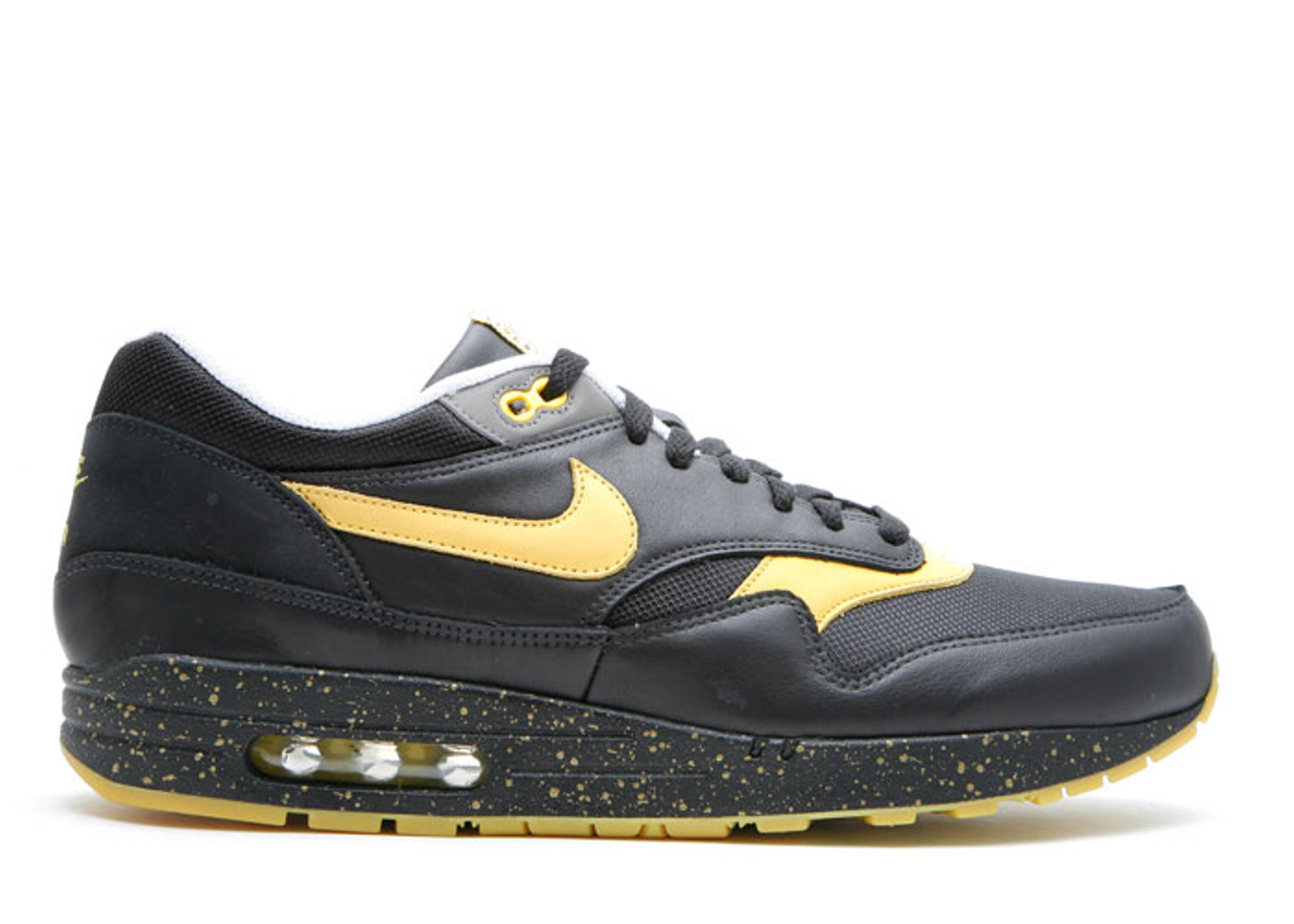 Nike Air Max 1 Livestrong Sneakers (Black/Vrsty Maize-Wht-Sft Gry)