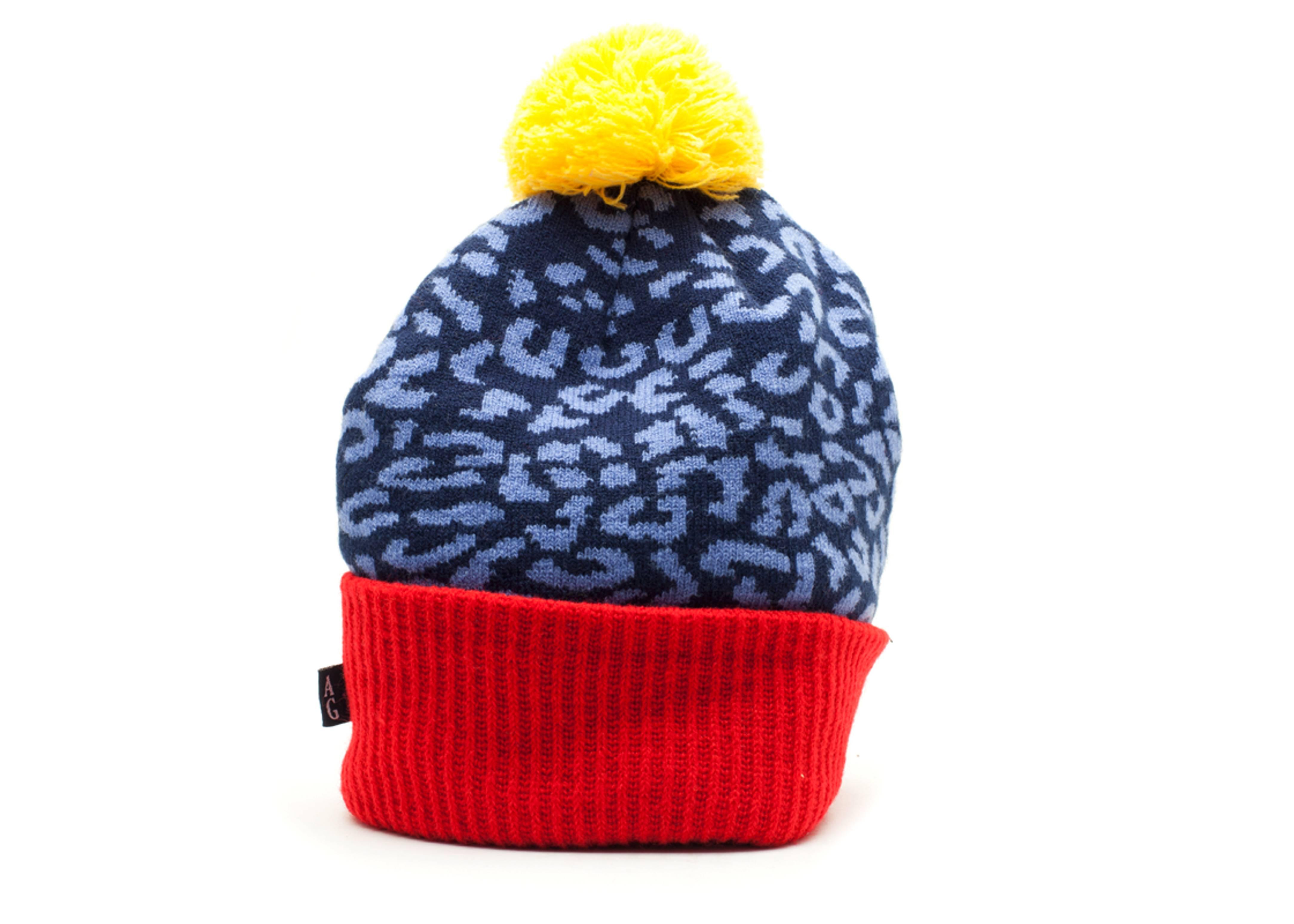 leopard cuffed pom knit beanie