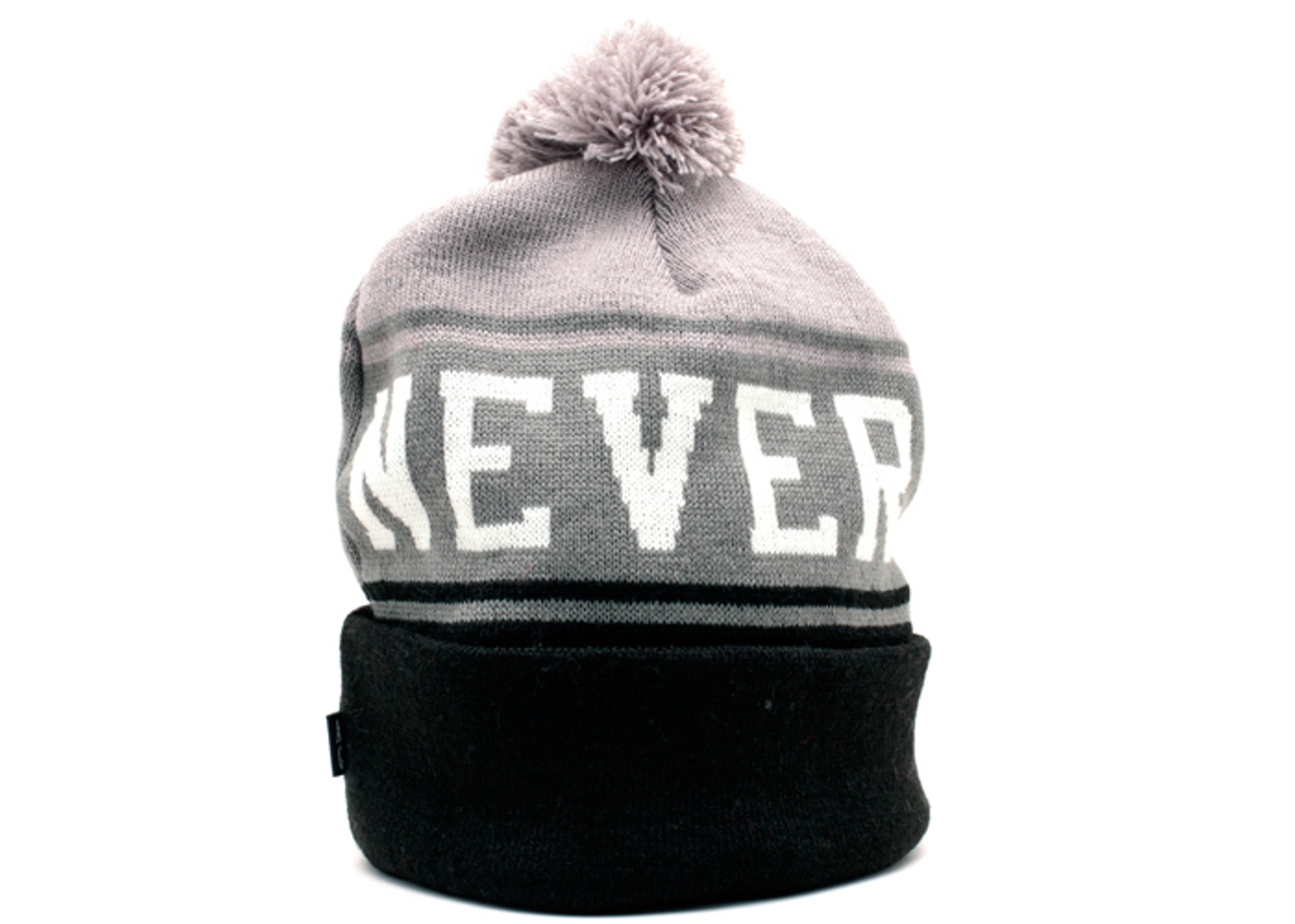never say die cuffed pom knit beanie